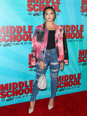 Paris Berelc topped off her ensemble with a silver drawstring purse.