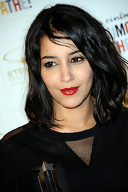 Leila Bekhti added a spicy touch to her look with classic red lipstick.