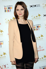 Sara dons a cream blazer over an LBD and dramatic tights for an award ceremony in France.