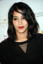 Leila Bekhti kept her locks lose and casual with a slightly wavy hairdo.