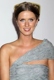 Nicky Hilton styled her hair in a center part braided bun for the Race to Erase MS Event.