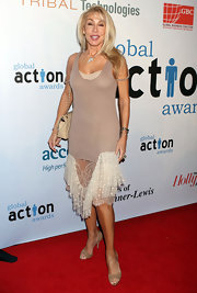 Linda Thompson went for a dainty-meets-sexy look with a nude lace-hemmed tank dress.