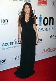 Joely dons a floor length black evening gown with a deep plunging neckline at the Global Action Awards Gala.
