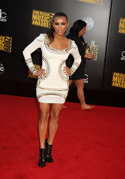 Melody wore a tribal-inspired, mini dress with metallic embellishments.