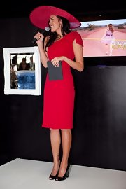 Megan Gale finished off her elegant look with a pair of chunky-heeled black peep-toes.