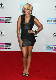 Keri Hilson stood out in black peep toes with gold metallic ankle straps. The heels looked fierce with Keri's glimmering LBD.