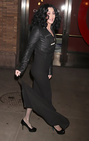 Cher paired her head to toe black ensemble with what else? Black patent platform pumps.
