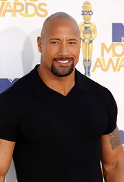 Dwayne Johnson shows off his new 'do at the MTV Movie Awards--but he kept the goatee.