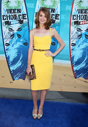 Jayma paired her sunny yellow cocktail dress with metallic ankle strap sandals.