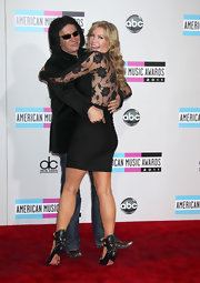 Shannon Tweed clung to her beau, showing off her LBD's sexy lace back.