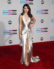 Selena Gomez topped off her stain gown with glittering strappy sandals.