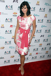 Catherine Bell looked demure and sweet in a bow-embellished pink and white print dress.
