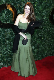 Katherine Schwarzenegger glammed it up at the QVC Red Carpet Style Party in a strapless sage green gown with she cinched at the waist with a black belt.