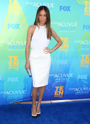 Maggie Q donned a white hot halter cocktail dress for the Teen Choice Awards. A tanned glow and pointy-toe pumps completed her look.