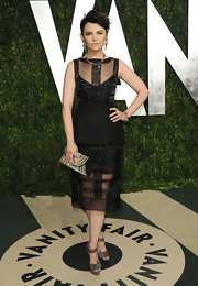 Ginnifer complemented her sheer LBD with platform evening sandals.