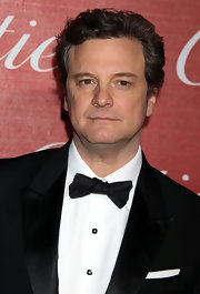 Actor Colin Firth paired his sleek suit with a classic bow tie.