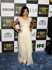 Zoe wore a sheer ivory Spring 2010 dress. The sweet bodice featured tiny capped sleeves and a folded neckline.