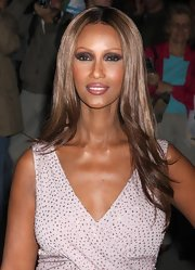Iman incorporated dark gray, aubergine and plum shadows into her eye makeup look at the 26th annual Night of Stars awards. The cool shades were echoed in her glossy mauve lipstick.