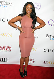 Jennifer Hudson toughened her rose body con dress with black Zipito zip-front booties.