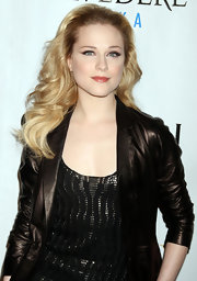 Evan Rachel Wood styled her voluminous tresses in bouncy curls that were swept back from her face.