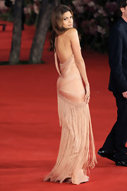 Eva shows off a nude pout at the Rome Film Festival.