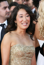Sandra looks amazing with her long curls. This is a change of style from her Grey's Anatomy character.