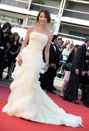 "Michelle Yeoh showed off a jaw-dropping dress while at the ""Wall Street"" premiere in Cannes. Her pale yellow organza tiered strapless gown is everything we would expect from Michelle."