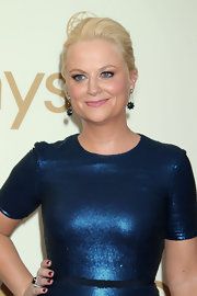 Amy Poehler added a pair of black diamond rose cut swing earrings to her glamorous look at the 63rd Emmys.