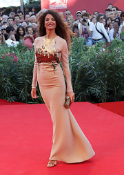 Afef Jnifen's nude dress with a stunning sequined front left quite an impression at the Venice Film Festival.