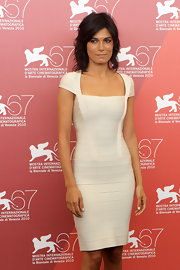 Valeria Solarino showed off her sleek figure in a white cap-sleeve bandage dress.