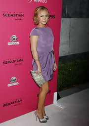 Hayden paired her violet draped dress with silver satin peep-toe slingbacks, which worked well with her snakeskin clutch.