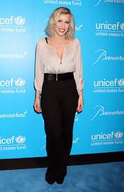 Natasha Bedingfield looked chic in a loose taupe blouse with a revealing keyhole neckline at the Snowflake Ball.