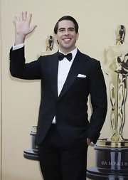 Eli Roth oozed elegance in a handsome black tuxedo.