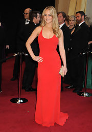 Jennifer Lawrence accented her winning 2011 Oscar look with a gold Emerald-Cut Full Bead Minaudier.