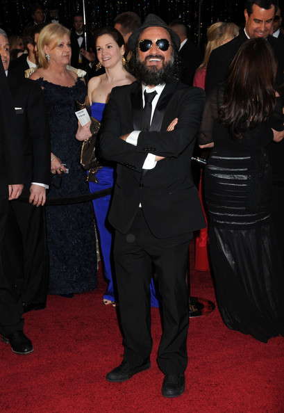 Theirra donned a classic black suit for the Oscars red carpet.