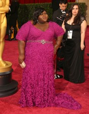 For the 2014 Academy Awards, Gabourey Sidibe went with a bold berry pink textured gown embellished with a sparkling belt.
