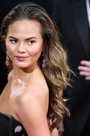 Chrissy Teigen accessorized with a pair of dangling gemstone earrings by Lorraine Schwartz for a totally breathtaking look.