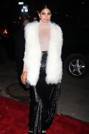 Rachel Roy layered a large fluffy white vest over a sheer turtleneck and velvet skirt at the CFDA Fashion Fund Awards.