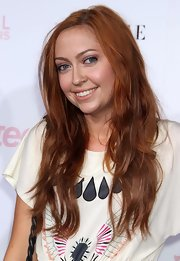 Brandi's hair is stunning in the varying shades of red.  Her loose waves give an effortless feel.