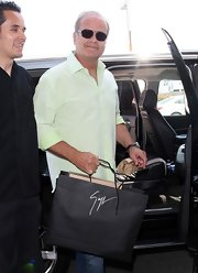 Kelsey Grammer was spotted at LAX looking cool in a mint-green button-down and square sunnies.