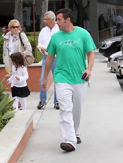 Adam showed off his love for the Jets football team while out with his daughter Sadie.