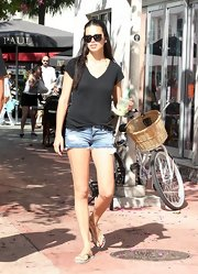 Adriana showed off her gorgeous gams in a super-short pair of denim cut-offs.