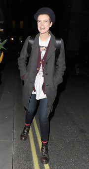 Agyness Deyn stuck to her signature tom boy style in a long gray coat and combat boots.
