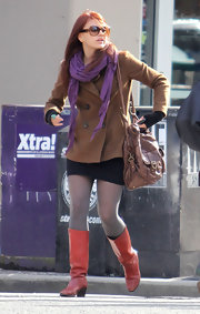 Aimee Teegarden went to see 'The Hunger Games' wearing a pair of shiny red boots.