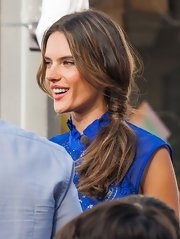 Alessandra Ambrosio's low side ponytail looked casual and effortless on the model as she filmed a segment for 'Extra!'