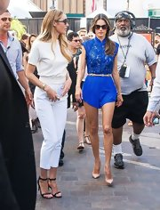 Alessandra Ambrosio kept her look for 'Extra' fun and flirty with this bright blue romper.
