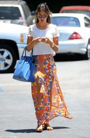 Alessandra Ambrosio amped up the summer feel with a double-slit floral maxi skirt.