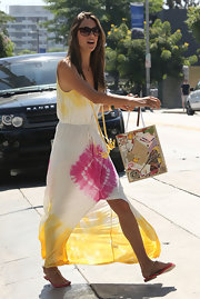 Alessandra looked colorful in this tie-dye maxi-dress while out shopping with her family.