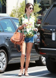 Alessandra Ambrosio looked cool and chic in a blurry-print blouse and a pair of cutoffs while getting lunch at Whole Foods.