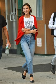 Alexa Chung completed her outfit with black ankle-wrap ballet flats.